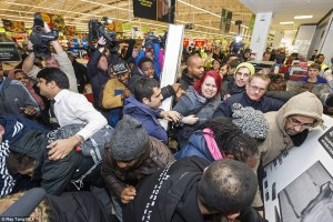 23910AEA00000578-2852835-Shoppers_scramble_to_pick_up_one-8_1417169462181